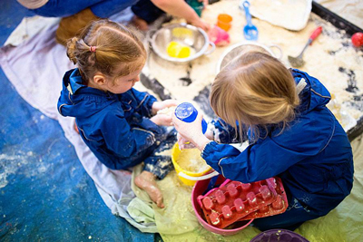 Messy play provides an excellent opportunity for under 5s to work on their fine motor skills.